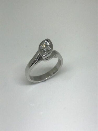 One only apparent platinum diamond solitaire ring.