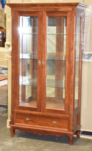 2 Door Timber Display Cabinet. Has 3 glass shelves, with 2 LED Down lights plus a bottom drawer. Dimensions 1100W x 480D x 2000H mm.