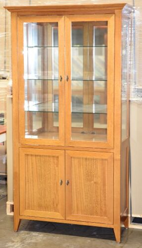 2 Door Timber Display Cabinet. Has 3 glass shelves, 2 Door storage below . Dimensions 1070W x 450D x 2000H mm.