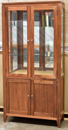2 Door Timber Display Cabinet. Has 2 glass shelves, 2 Door storage below . Dimensions 980W x 400D x 2000H mm.