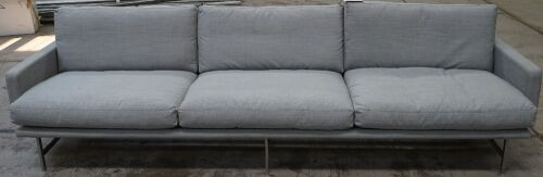 Lissoni 3 seater sofa with armrests, two blemishes on rear of lounge.