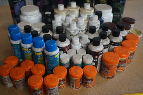 Box of assorted aquarium products comprising of 15 containers Tetra Fin Goldfisg flakes, 3 containers Prodac Tablet Vitamins, 2 Ultra Lith, Special Ziolith, 1 Neptune Cube Landscaping Glue, 15 containers various sizes Seachem Reef Stronium, 6 containers F