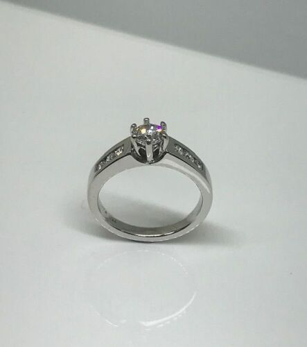 One Only 18ct White Gold Diamond Shouldered Solitaire Ring